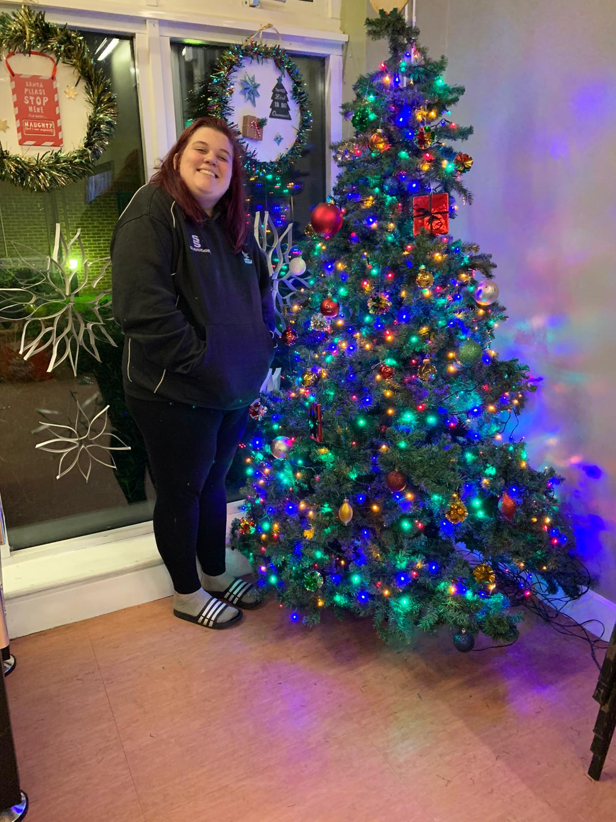 woman standing by a Christmas tree